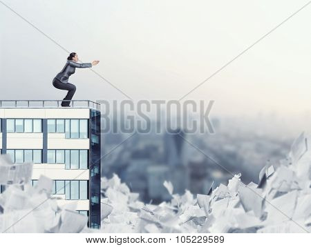 Woman on the edge of a high office building is going to jump to paperwork