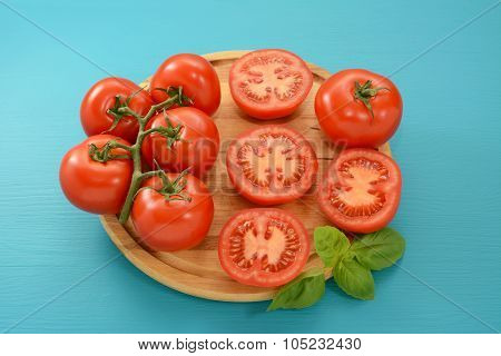 Tomatoes - Cut, Whole And On The Vine With Fresh Basil