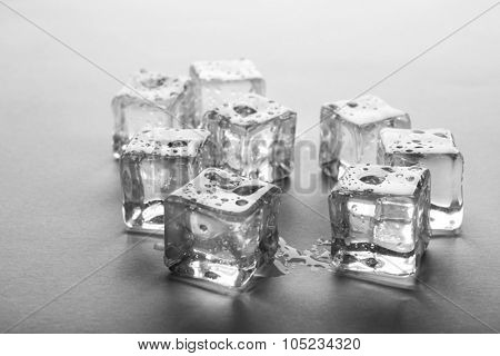 Clear melting ice cubes, close up