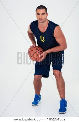 Full length portrait of a man playing in basketball isolated on a white background