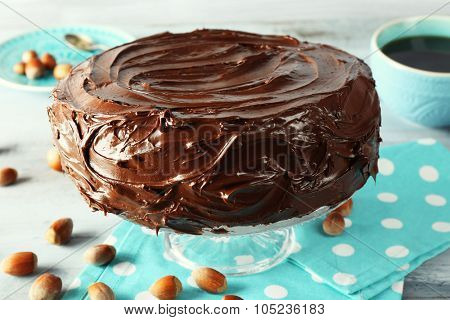 chocolate cake with hazelnuts and coffee on table