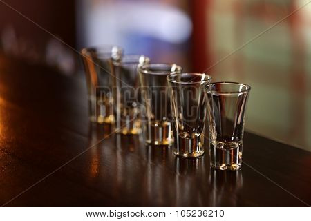 Empty shot glasses on bar counter