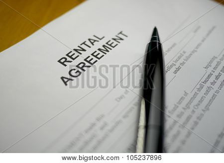 black pen lying on a rental agreement