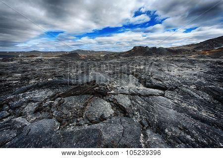 Inhospitable dramatic volcanic landscape at Krafla geothermal area, Iceland