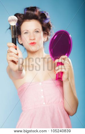 Woman In Hair Rollers Holds Makeup Brush