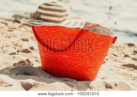 Wicker Basket Handbag Bag And Hat On Summer Beach.