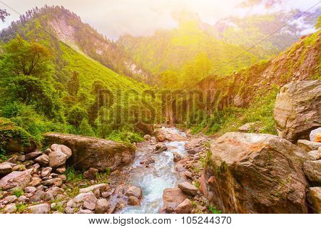 Beautiful landscape with mountain river and rocks under sunshine in Nepal,  Annapurna trekking