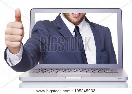 Business man thumbs up through a laptop, isolated on white background