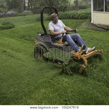 Man cutting grass with lawnmower