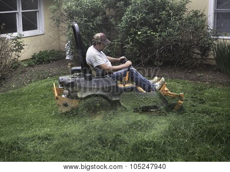 Man mowing grass on lawnmower