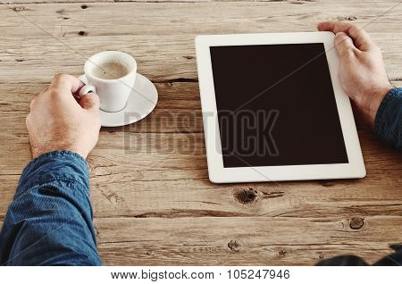 Male Hands Holding A Tablet Computer With Blank Screen Closeup