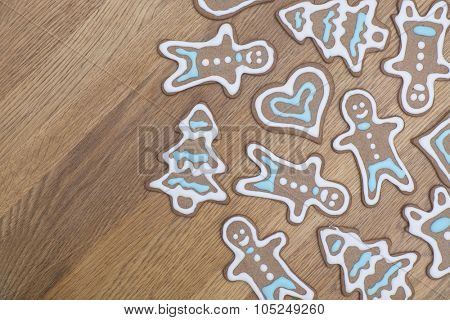 Variety of gingerbread cookies on a wooden table