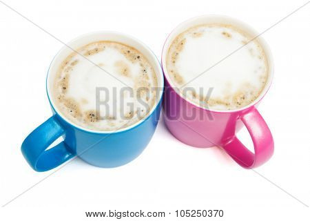 two cups of cappuccino on a white background