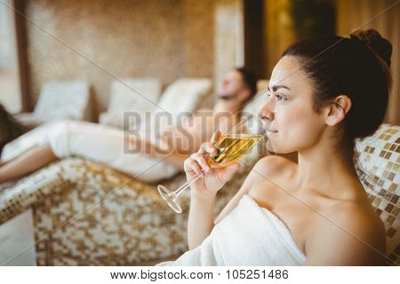 Woman enjoying her champagne at the spa