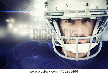 Portrait of stern American football player against american football arena