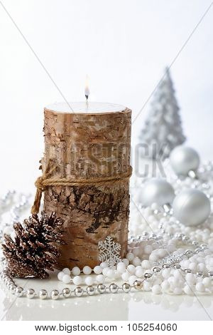 Natural christmas decoration with candle and pineal.