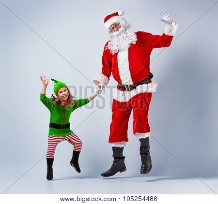 Santa and elf having fun and dancing.
