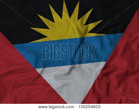 Closeup of ruffled Antigua and Barbuda flag