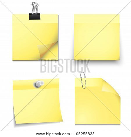 Yellow sticky blank notes with office supplies