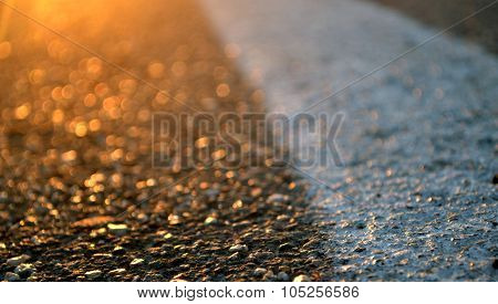 Asphalt Road And Orange Sunset