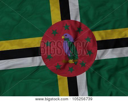 Closeup of ruffled Dominica flag