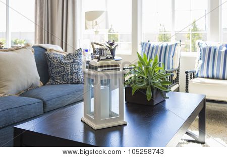 Beautiful Blue Accented Living Area with Coffee Table, Couch and Chairs of Home.