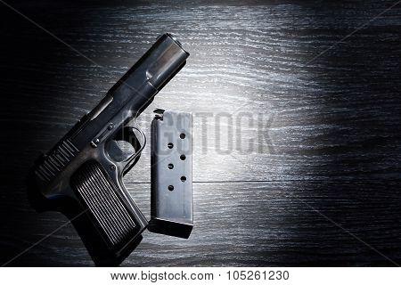 Pistol And Holder On Dark