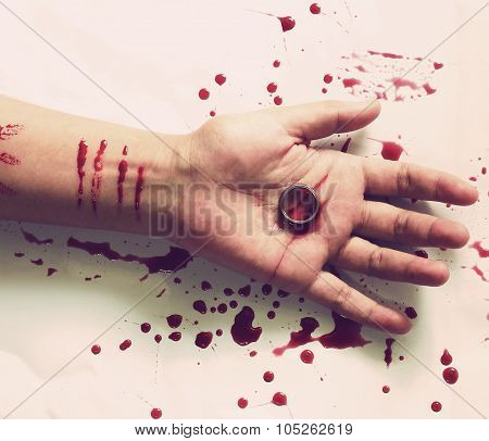 Female Suicide,knife And A Ring On The Hand