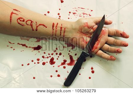 Female suicide with fear messages , Knife and a ring on the hand