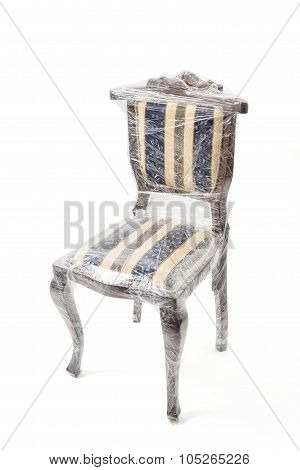 Chair In Retro Style Packaged In Foil With Clipping Path.