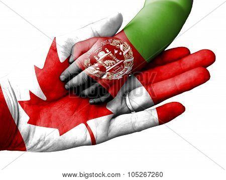 Adult Man Holding A Baby Hand With Canada And Afghanistan Flags Overlaid. Isolated On White