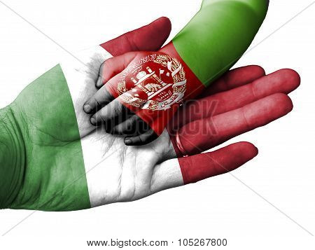 Adult Man Holding A Baby Hand With Italy And Afghanistan Flags Overlaid. Isolated On White