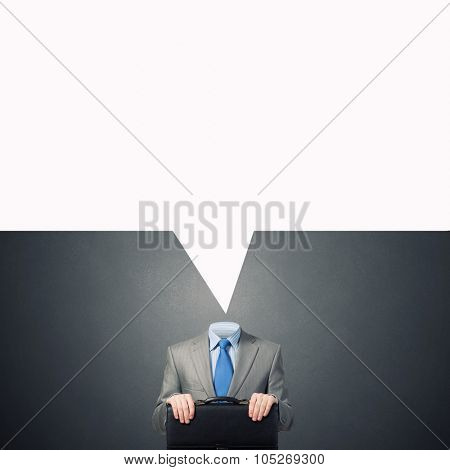 Headless businessman with  speech bubble instead of head