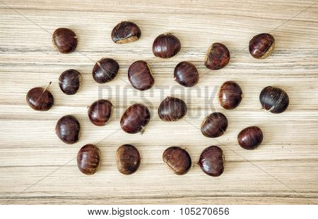 Chestnuts Scattered On The Wooden Table
