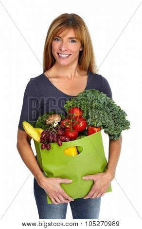 Woman with grocery bag of vegetables isilated white background.
