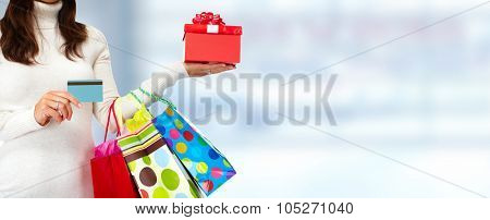 Shopping woman with Christmas gifts and credit card.