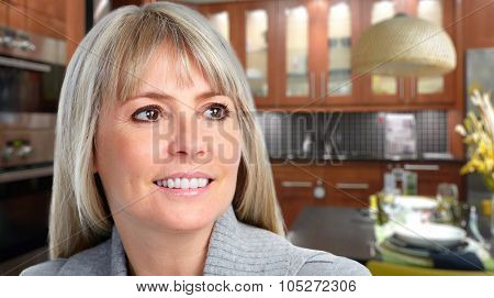 Beautiful smiling woman in a modern house. Relaxing at home.