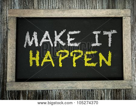 Make it Happen written on chalkboard