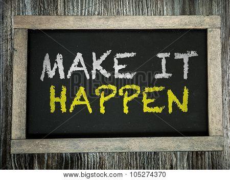 Make it Happen written on chalkboard