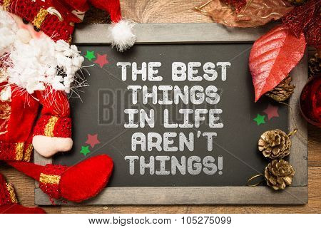 Blackboard with the text: The Best Things In Life Aren't Things in a christmas conceptual image