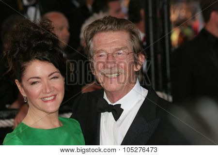CANNES, FRANCE - MAY 18: Actor John Hurt and guest attends the Indiana Jones  premiere at the Palais des Festivals during the 61st Cannes International Film Festival on May 18, 2008 in Cannes, France.