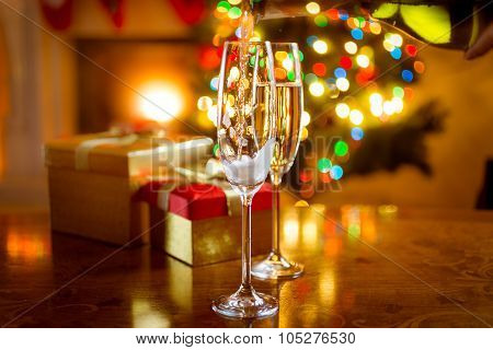 Decorated Dinning Table For Christmas With Glasses Of Champagne