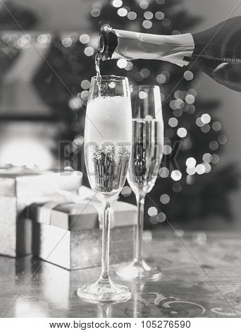 Two Champagne Glasses On Table At Living Room Decorated For Christmas