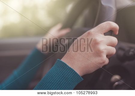 Safe Driving, Woman Grips Car Steering Wheel