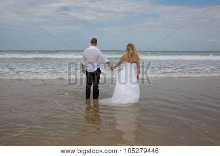 An Attractive Bride And Groom Getting Married By The Beach