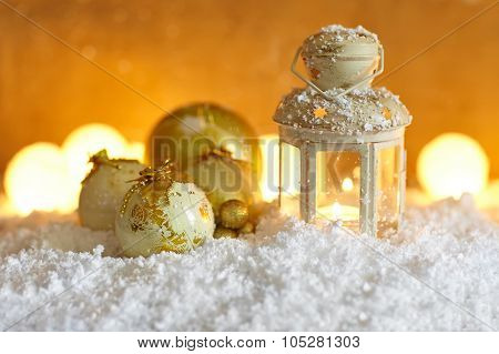 Christmas Background With Christmas Baubles And Lantern In Snow