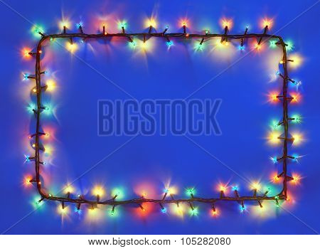 Christmas Lights Frame On Dark Blue Background