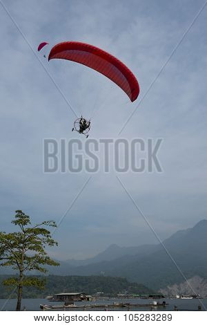 Single paragliding flying in the sky