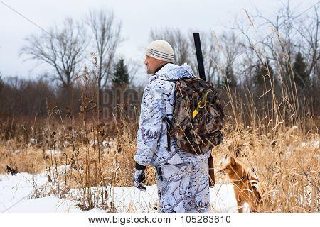 Hunter On Snowy Field