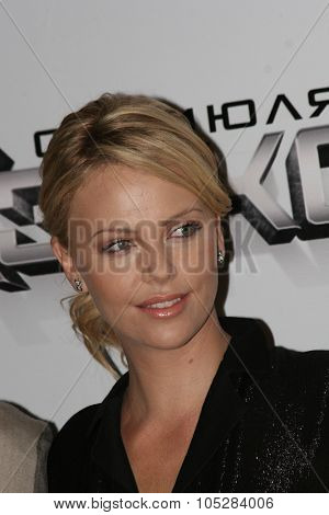 MOSCOW - JUNE 19: Charlize Theron burst into laughter before holding a press conference , prior to the Russian premiere of  'Hancock' on XXX Moscow  film festival  on June 19, 2008 in Moscow, Russia.